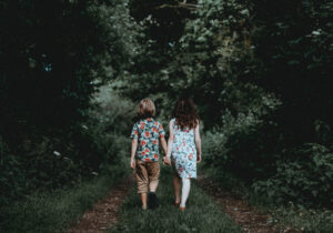 Adolescent couple taking a walk in the woods after couples counselling in Calgary