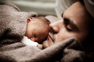 Man-Hugs-His-Sleeping-Baby-scaled