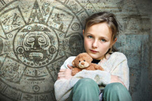 abused child hiding with teddy bear in front of mayan calendar