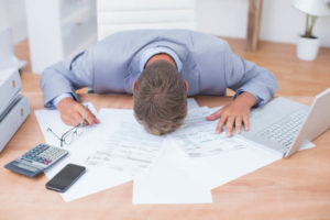 businessman-sleeping-by-accounting-picture