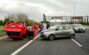 Car accident rollover of red car stress and trauma photo