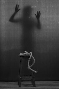 grayscale photo of rope on stool at BDSM club