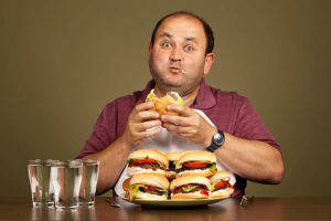 man-eating-many-burgers-picture
