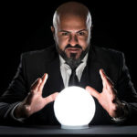 A fortune teller holds a crystal ball