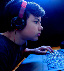 calgary depression hotline teenager gaming on his laptop picture
