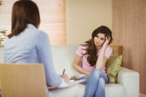 Image of a Calgary depression support therapist listening to her patient