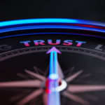 Compass pointing towards the word trust