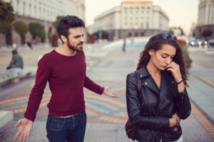 unhappy couple fighting outside picture