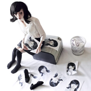 Woman in white long-sleeved shirt sitting on grey and black chest surrounded by the false images of herself