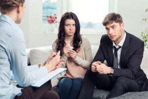Calgary sex therapy couple receiving advice at a psychologist office picture