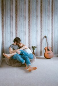 young Calgary Counselling Services couple passionately kissing on bean bag chair
