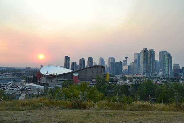 Sunset over the city of Calgary's Saddle Dome, home of Henze & Associates Individual Counselling Calgary services for depression, anxiety, addictions and so much more!